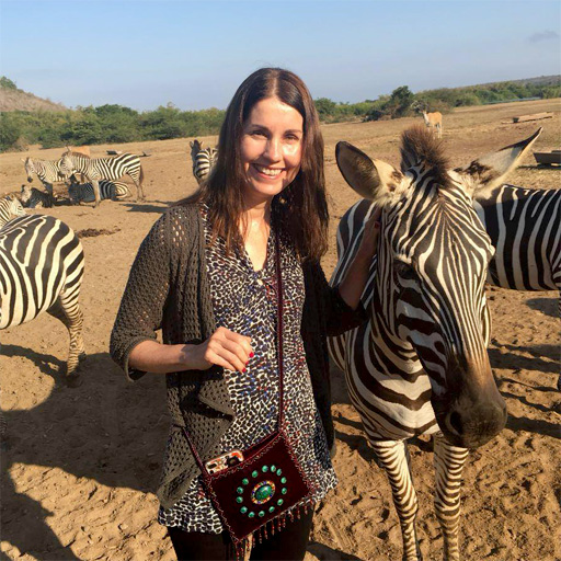 Maureen with zebras